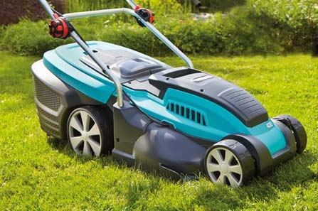 A Gardena lawn mower on a grassy lawn