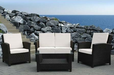 A set of patio furniture with a waterfront background