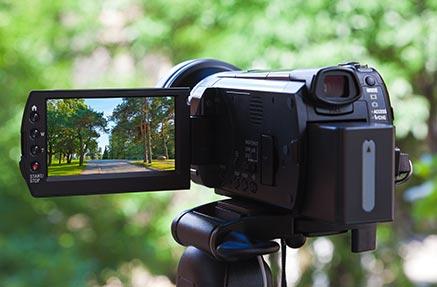 A video camera filming greenery