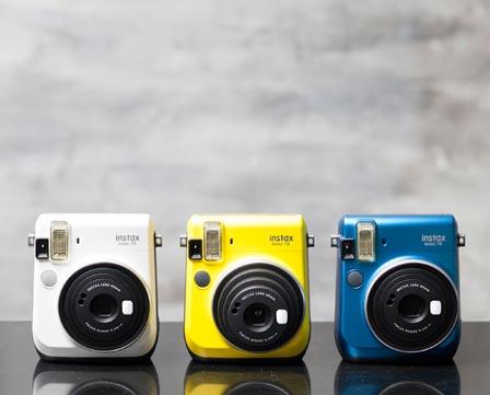 Fujifilm Instax Mini 70 in 3 colours, white, yellow, and blue