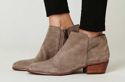 A hair of beige suede ankle booties