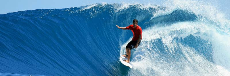 A man surfing a large wave